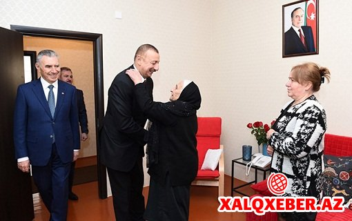 İlham Əliyev məcburi köçkün ailəsinə qonaq getdi - Foto